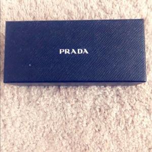 Never worn still in box Prada sunglasses